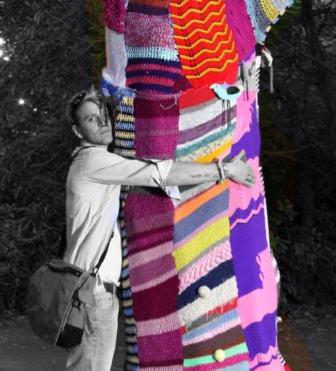 The Graffiti Grannies yarn-bombed tree at Port Eliot gets a hug...
