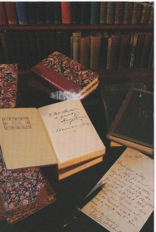 Edith Wharton's library desk with original works and artifacts from The Mount's collection