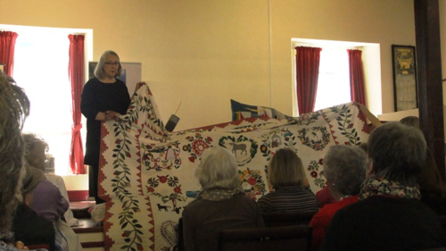 Jo Colwill with her Baltimore Album quilt