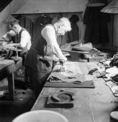 Savile_Row-_Tailoring_at_Henry_Poole_and_Co.,_London,_England,_UK,_1944_D21862