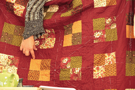 Trcay Chevalier and her quilt